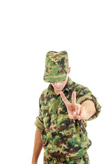 soldier uniform and hat standing and showing the peace sign with