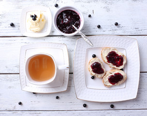 Fresh toasts with homemade butter and blackcurrant jam
