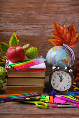 time for school concept on wooden background