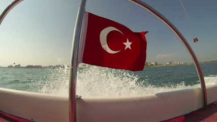 Turkish Flag on Motor Boat Waving in the Wind