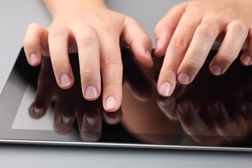 Hands Using Digital Tablet