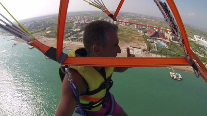 Man Parasailing High in the Sky