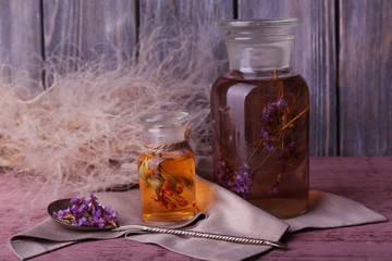Bottle of herbal tincture and brunch of flowers