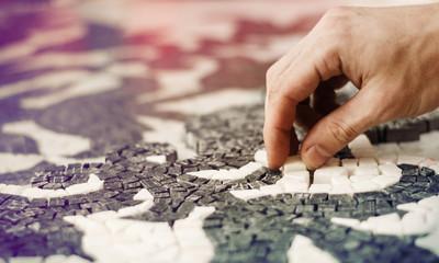 Man making mosaic