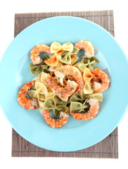 Fresh prawns with coloured macaroni in a big blue plate