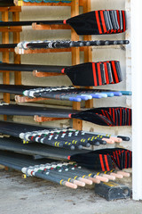 Oars stacked in boat shed