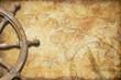 Leinwanddruck Bild - aged treasure map with steering wheel