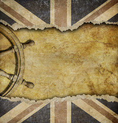 Grunge British flag and old steering wheel