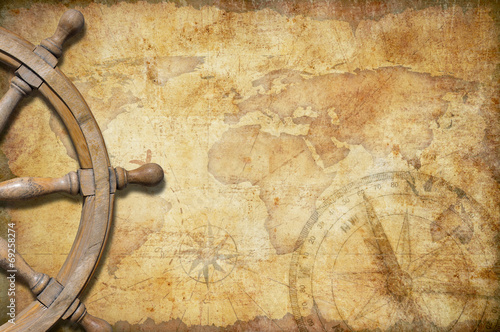 Leinwandbild Motiv aged treasure map with steering wheel