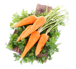 Carrots and parsley on cutting board isolated on white