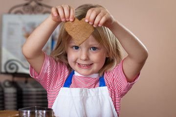 Cute boy baking ginger bread cookies