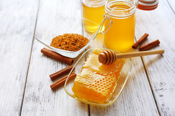 Fresh honey on wooden table