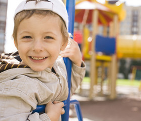 little cute boy on swing outside