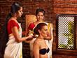 Woman having ayurveda spa treatment.