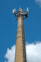 Old factory chimney with GSM antennas