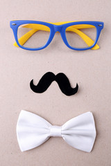 Glasses, mustache and bow tie forming man face