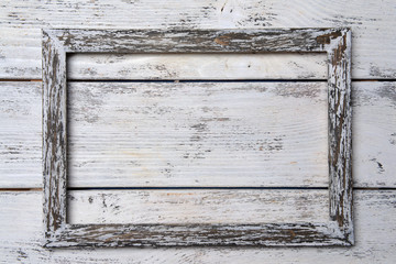 Vintage frame on wooden background