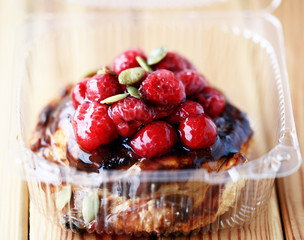 Cake with berries in a plastic bag, home delivery