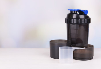 Whey protein powder and plastic shaker