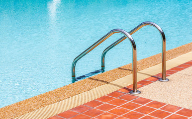 Ladder of swimming pool in summer time