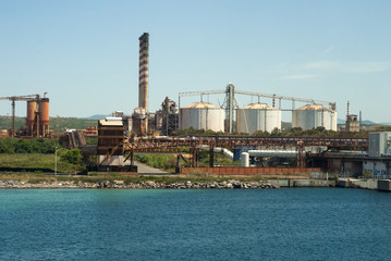 Petrochemical factory with tanks and pipelines nature