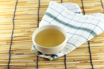 Japanese tea on a bamboo background.