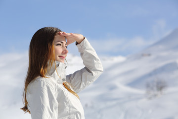 Hiker woman looking forward in the snowy mountain