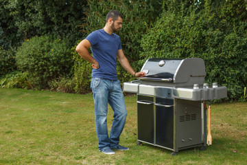 Man standing by a grill