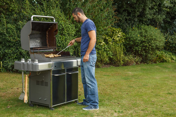 Man at a barbecue grill