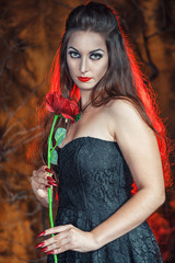 Beautiful woman with rose in halloween style