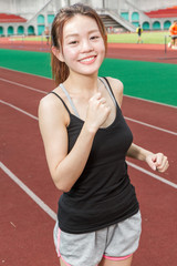 Chinese woman on sports track jogging
