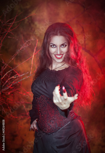 Poster Beautiful woman in halloween style beckoning finger
