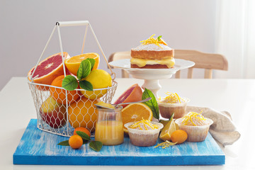 Citrus candy bar with fruits and cakes