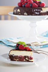 Cheesecake with berries on a brownie layer