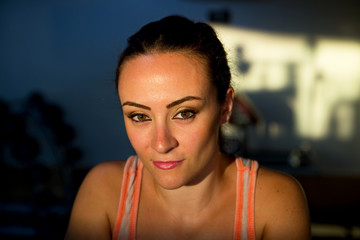 portrait of a beautiful young woman at the gym