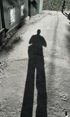 Shadow of a man coming home