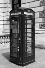 Traditional telephone booth in London, black and white photo