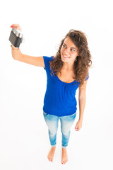 Young cute woman takes a selfie