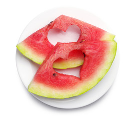 Slices of watermelon with cut out heart shape