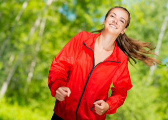 healthy young female athlete running