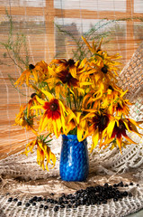 bouquet of bright yellow flowers on the window sill
