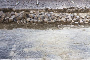 Road repairs in a stone road