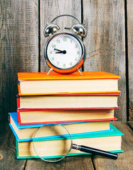 Books and an alarm clock.