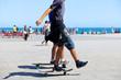 Skateboarding on the beach. - 69268474