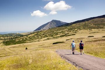 Tourists walking on trip, Czech mountains