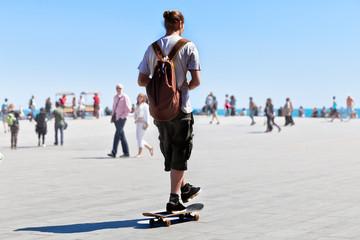 Skateboarding on the beach.