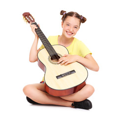 Happy girl and guitar