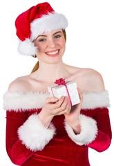 Pretty girl in santa costume holding gift box