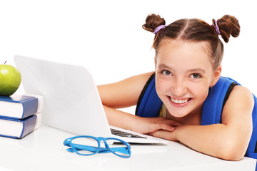 Happy girl doing homework on computer