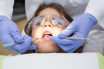 Dentist examining a boys teeth